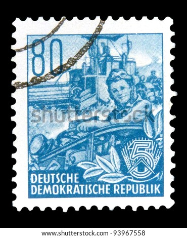"GDR - CIRCA 1953: A stamp printed in GDR (German Democratic Republic - East Germany) shows a Harvester in the field without inscription from the series ""Workers For The Five-year Plan"", circa 1953"
