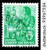 """GDR - CIRCA 1953: A stamp printed in GDR (German Democratic Republic - East Germany) shows a Woman at wheel switch without the inscription, from the series """"Workers For The Five-year Plan"""", circa 1953 - stock photo"""