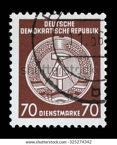 GDR - CIRCA 1952: A Stamp printed in GDR (German Democratic Republic - East Germany) shows DDR national coat of arms with inscription Service Stamp, series GDRs national coat of arms, circa 1952 - stock photo