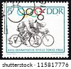 GDR - CIRCA 1964: A stamp printed in GDR shows Bicycling, 18th Olympic Games, Tokyo 64, circa 1964 - stock photo