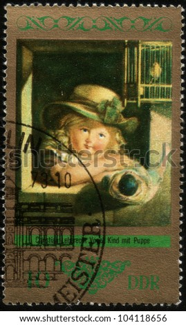 GDR - CIRCA 1973: a stamp printed in GDR shows Child with doll, Painting by Christian Lebrecht Vogel, circa 1973