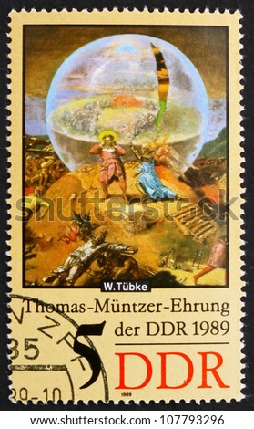 GDR - CIRCA 1989: a stamp printed in GDR shows Globe, Detail of the Painting Early Bourgeois Revolution in Germany in 1525 by Werner Tubke, circa 1989 - stock photo