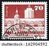 GDR - CIRCA 1973: a stamp printed in GDR shows Old Town Hall and Office Building, Leipzig, circa 1973 - stock photo