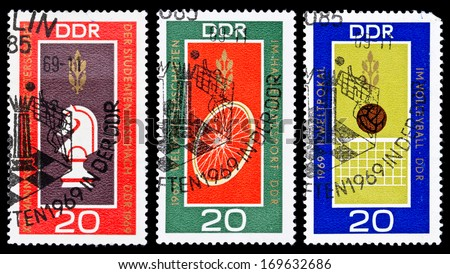 GDR - Circa 1969: Set of GDR stamps dedicated to Students  chess world championship in Drezden, Volleyball world cup in Erfurt and Track cycling world championship in Erfurt, East Germany, circa 1969. - stock photo