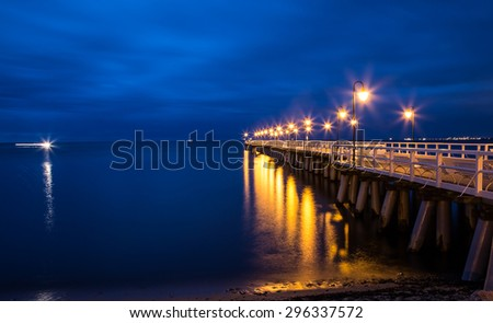 Gdynia Orlowo pier. Vintage photo of Baltic sea shore seascape.sunrise at seaside - stock photo