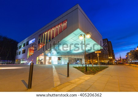 GDYNIA, POLAND - APRIL 8, 2016: Building of Gdynia Film Center at night, Poland. Gdynia is an important seaport of Gdansk Bay on Baltic Sea and part of metropolitan area called the Tricity.