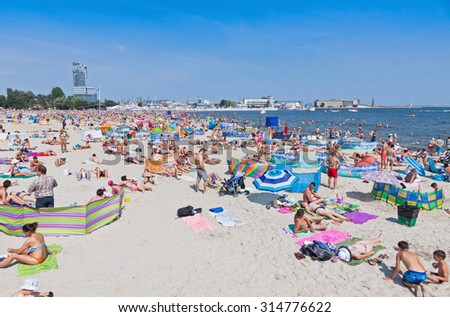 GDYNIA, POLAND - AUGUST 2, 2015: Crowded Municipal beach in Gdynia city, Baltic sea, Poland - stock photo
