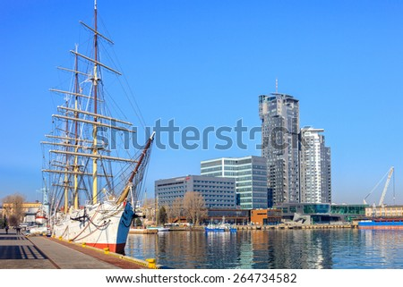 GDYNIA, POLAND-MARCH 18: Polish training tall ship Dar Pomorza on the background of the city of Gdynia on March 18, 2015 in Gdynia,Poland. Gdynia is a port city, the organizer of the Tall Ships' Races - stock photo