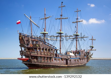 "GDYNIA, POLAND - MAY 19: ""Dragon"" - pirate ship on the water of Baltic Sea in Gdynia on 19 May 2013. This ship imitating XVII century galleon is big tourist attraction of Tri city in Poland. - stock photo"