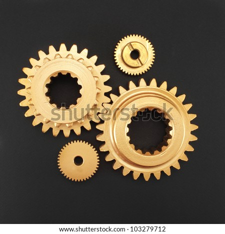 gear gold on a black background - stock photo