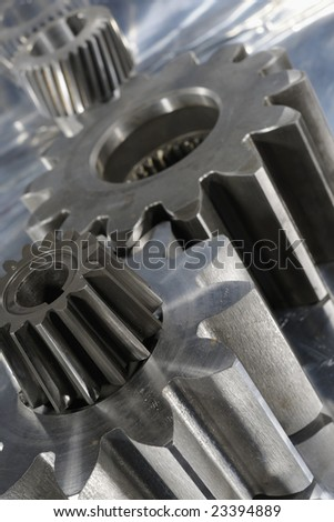 gear machinery concept against steel, natural metal colors