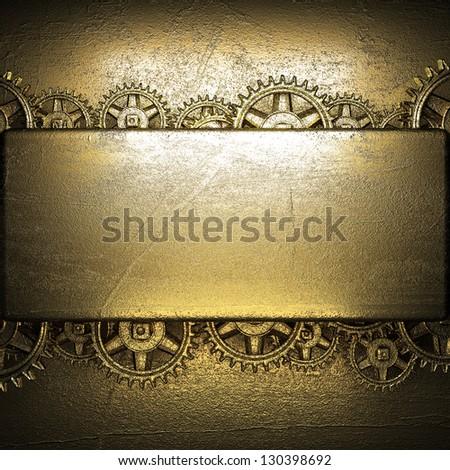 gear wheels on golden background - stock photo