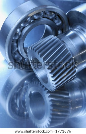 gears and ball-bearing in a luminous bluish tint - stock photo