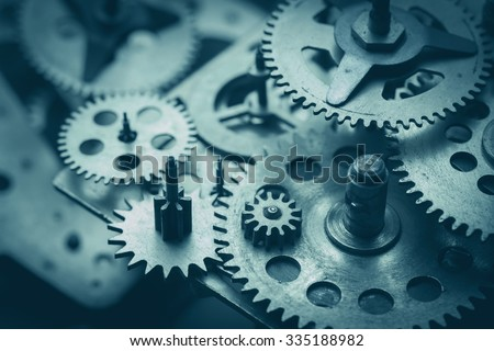 Gears and cogs macro, blue toned - stock photo