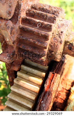 gears and cogs pulley. Rusty machine for winding cable for fishing net and boats - stock photo