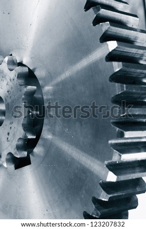 gears and cogwheels in steel, slight blue toning concept - stock photo