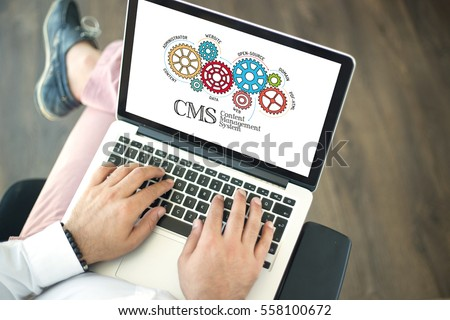 Gears and Content Management System Mechanism on Laptop Screen