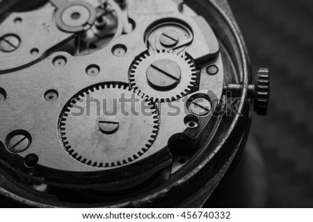 Gears and mainspring in the mechanism of watch.