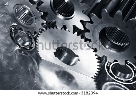gears and pinions against steel and in a bluish cast