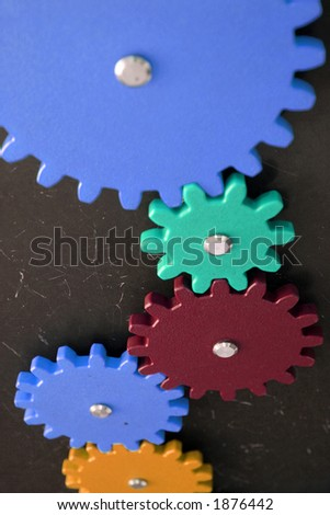 Gears mesh with others, perspective view. Shallow DOF - stock photo
