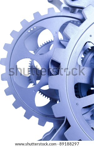 gears of a clock in blue, photographed with a macro lens - stock photo