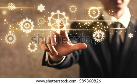 Gears with businessman on dark vintage background