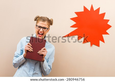 Geek girl is very angry because she has to learn.Angry geek girl - stock photo