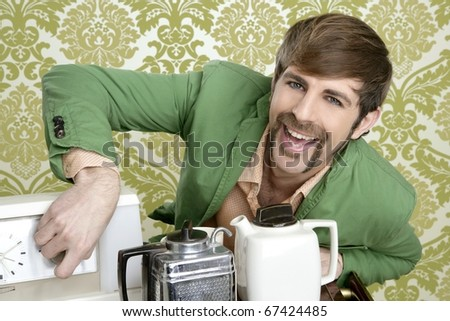 geek retro man drinking tea coffee vintage teapot in wallpaper - stock photo