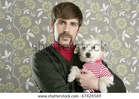 geek retro man holding dog silly couple on wallpaper - stock photo