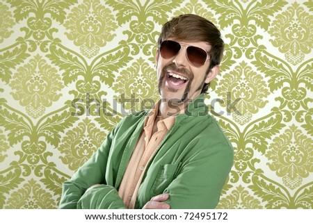 geek retro salesperson man funny mustache sunglasses in green wallpaper - stock photo