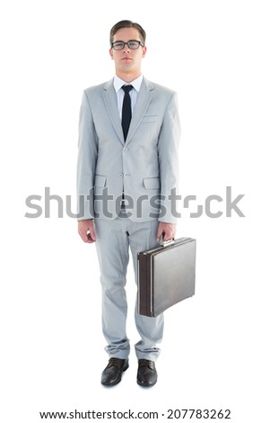 Geeky businessman holding his briefcase on white background
