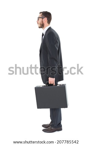 Geeky businessman holding his briefcase on white background - stock photo