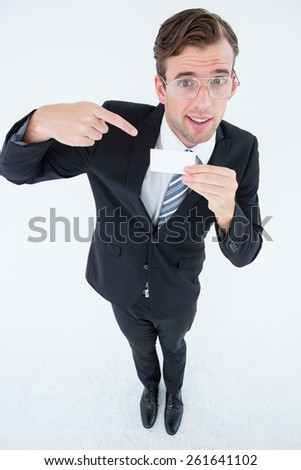 Geeky businessman showing card on white background - stock photo