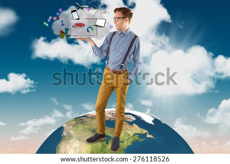 Geeky businessman showing his laptop against cloud computing graphic with apps - stock photo
