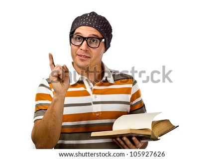 Geeky guy wearing thick black nerd glasses holding a book - stock photo