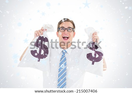 Geeky happy businessman holding bags of money against snow falling - stock photo