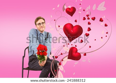 Geeky hipster holding a bunch of roses against pink - stock photo
