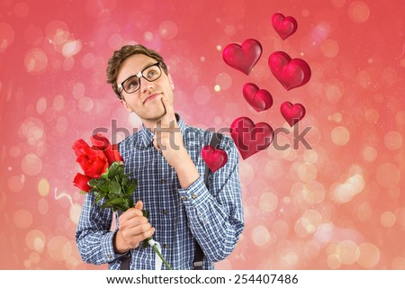 Geeky hipster holding a bunch of roses against red abstract light spot design - stock photo