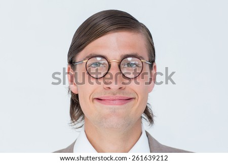 Geeky hipster looking at camera on white background