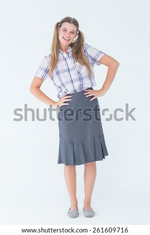 Geeky hipster with hands on hips on white background - stock photo