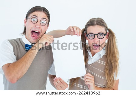 Geeky hipsters holding a poster on white background - stock photo
