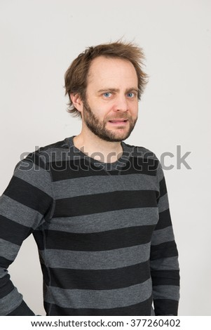 Geeky man in striped shirt  - stock photo