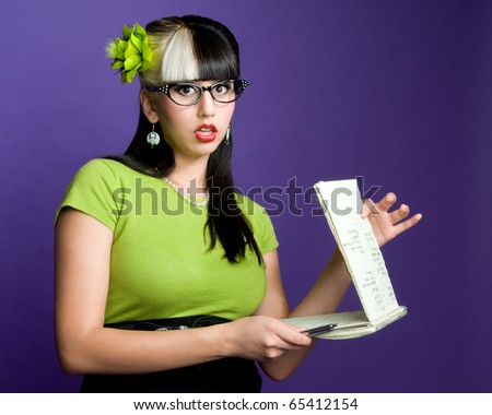 Geeky secretary holding steno pad and pen - stock photo