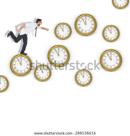 Geeky young businessman running late against clocks - stock photo