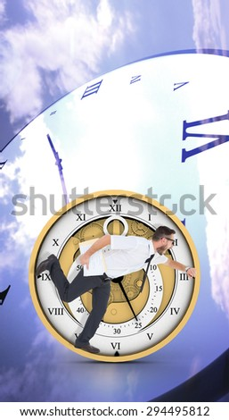 Geeky young businessman running late against digitally generated roman numeral clock - stock photo