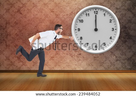 Geeky young businessman running late against grimy room - stock photo
