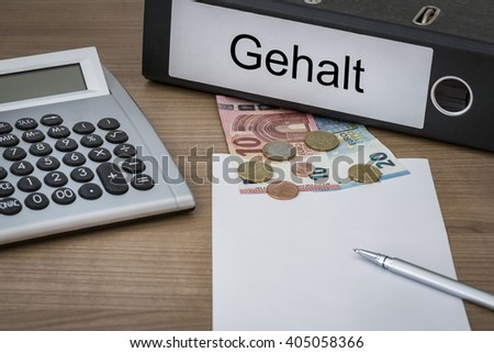 Gehalt (german Wages) written on a binder on a desk with euro money calculator blank sheet and pen