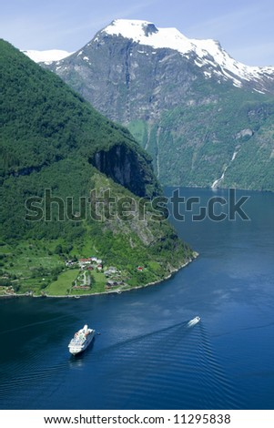Geiranger fjord from the top of the mountain, ships, snow - stock photo