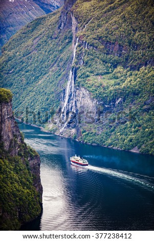 Geiranger fjord, waterfall Seven Sisters. It is a 15-kilometre (9.3 mi) long branch off of the Sunnylvsfjorden, which is a branch off of the Storfjorden (Great Fjord). - stock photo