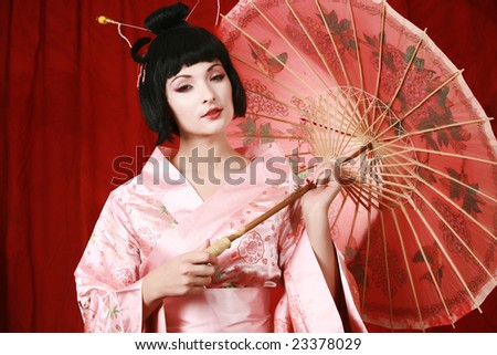 geisha posing isolated on red - stock photo